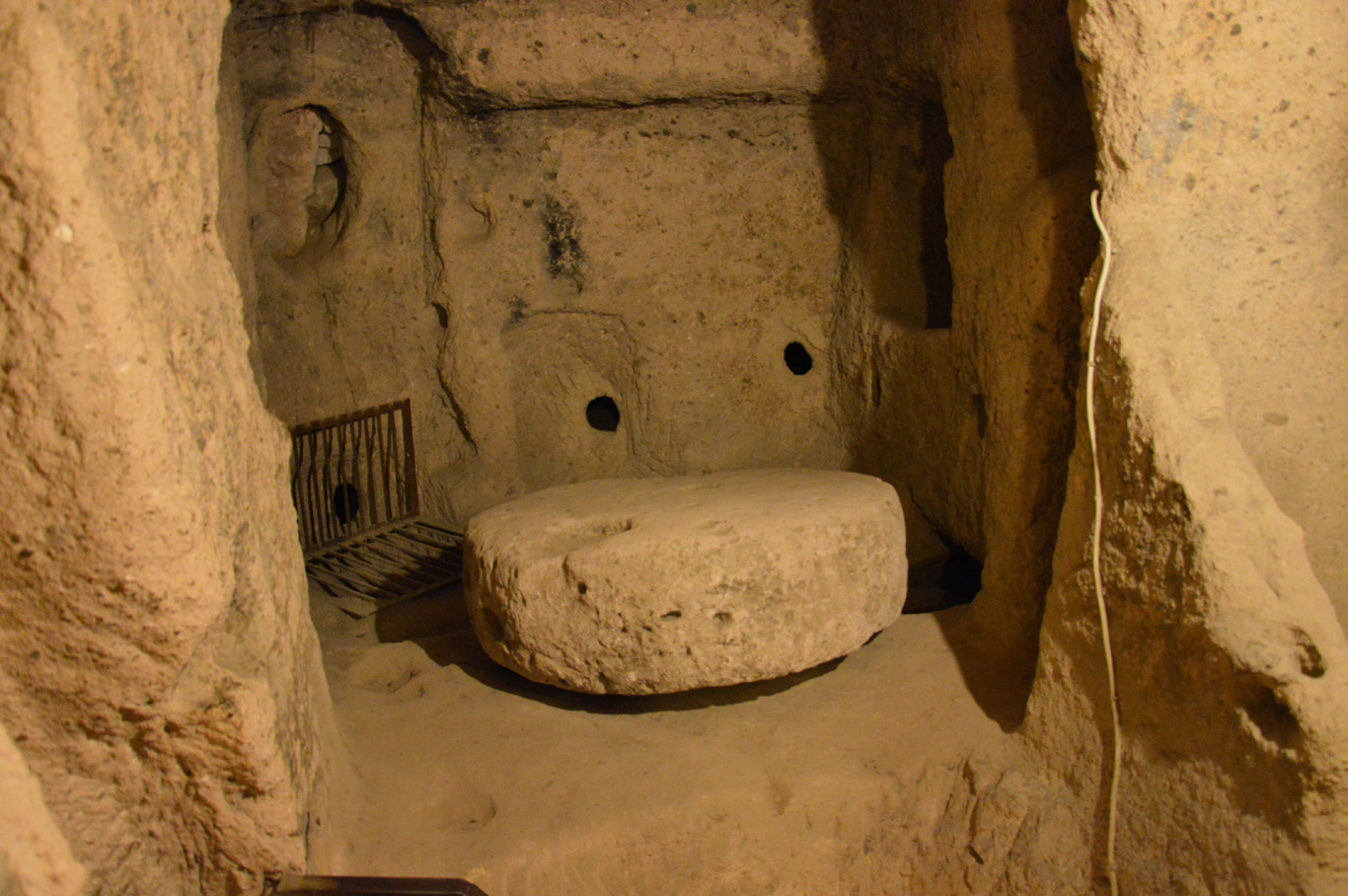 Kaymakli Underground City - stone used to grind grapes for wine