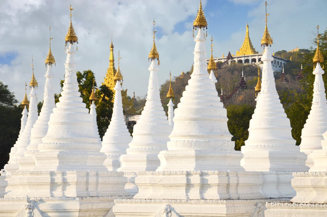 White stupas of Sandamuni Pagoda - Mandalay Hill in the back
