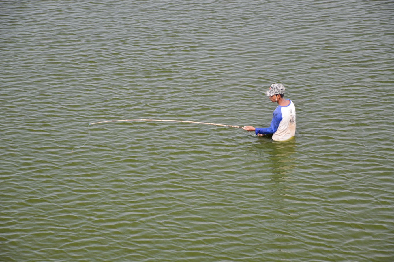 I'm not sure fishing in this lake is a great idea... Local people probably have no choice...