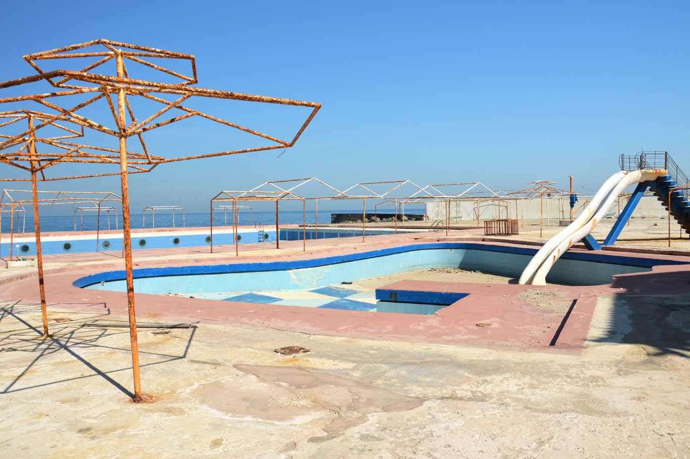 Abandoned swimming pool area near the coast