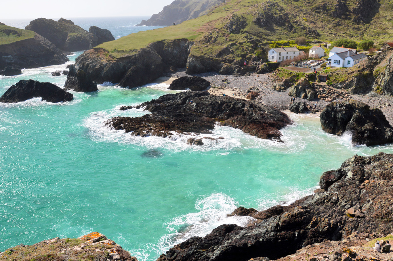 Black rocks contrast with turquoise waters at Kynance Cove