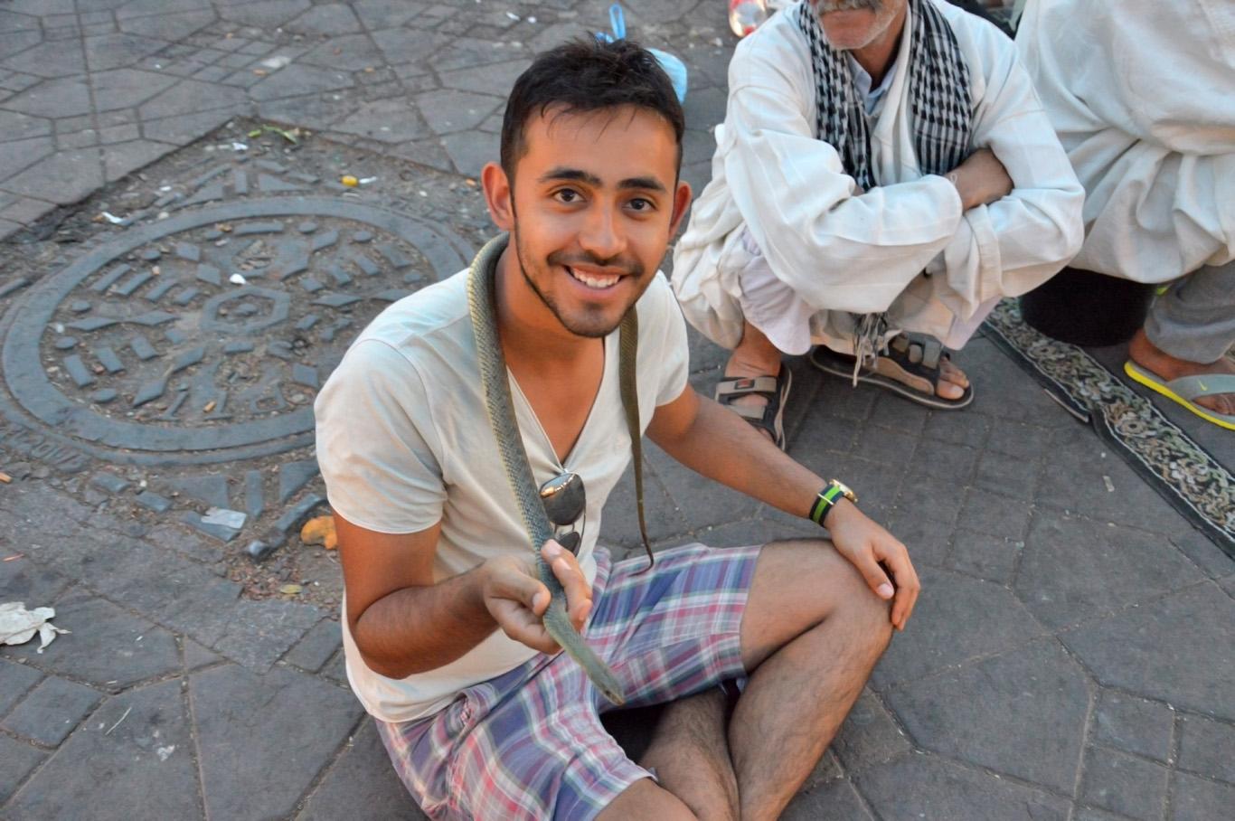 Holding a snake in Medina
