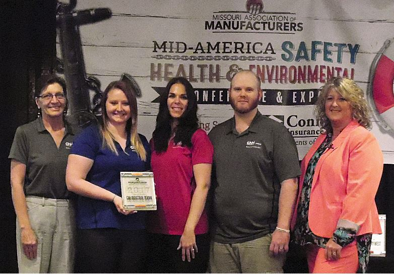 CNH Industrial Reman receiving their Safety Manufacturing Company of the Year Award from MAM's CEO, KIM Inman