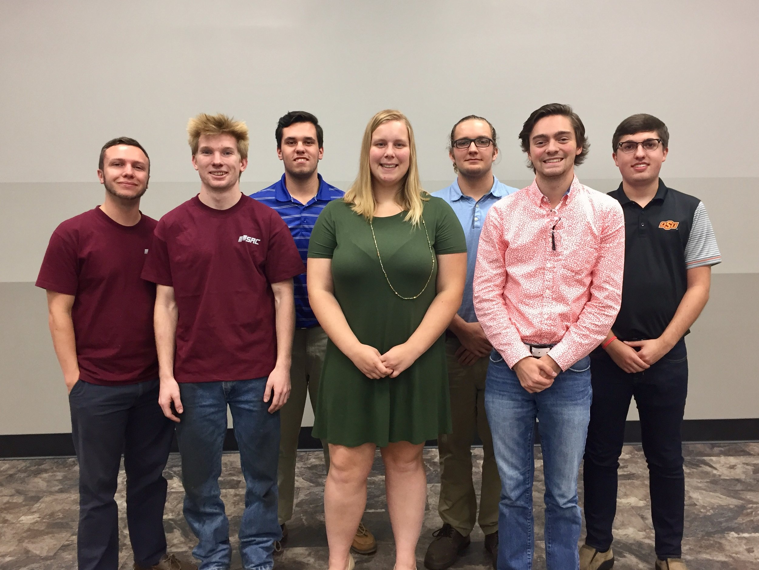 Logan Kunkel (back row; left) and Westin Easley (back row; middle), along with the fellow interns at Springfield Remanufacturing Corporation's Heavy Duty location, gave presentations about their summer projects to their superiors.