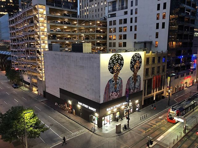 """In 2018, Jasmine Zelaya's painting """"Twins"""" was displayed on a billboard- sized installationin Downtown Houston. Check out her conversation with Erika B Hess, artists and founder, @ilikeyourworkpodcast with our newly published interview! Read in Volume 9 or at friendoftheartist.com/blogs/jasmine-zelaya #foa #contemporaryart #houston #installation #painting #art"""