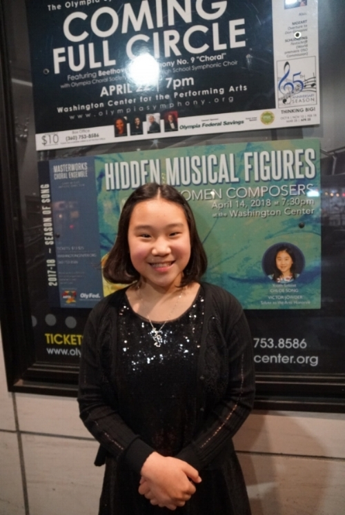 Chloe smiling in front of her poster at the Washington Center.  This must be after her performance, she looks so happy!