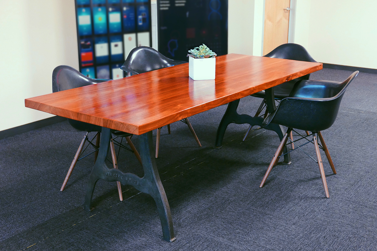 Office table with African padauk top. The steampunk legs are salvaged circa-1850 cast iron from an unknown industrial factory in New York City.