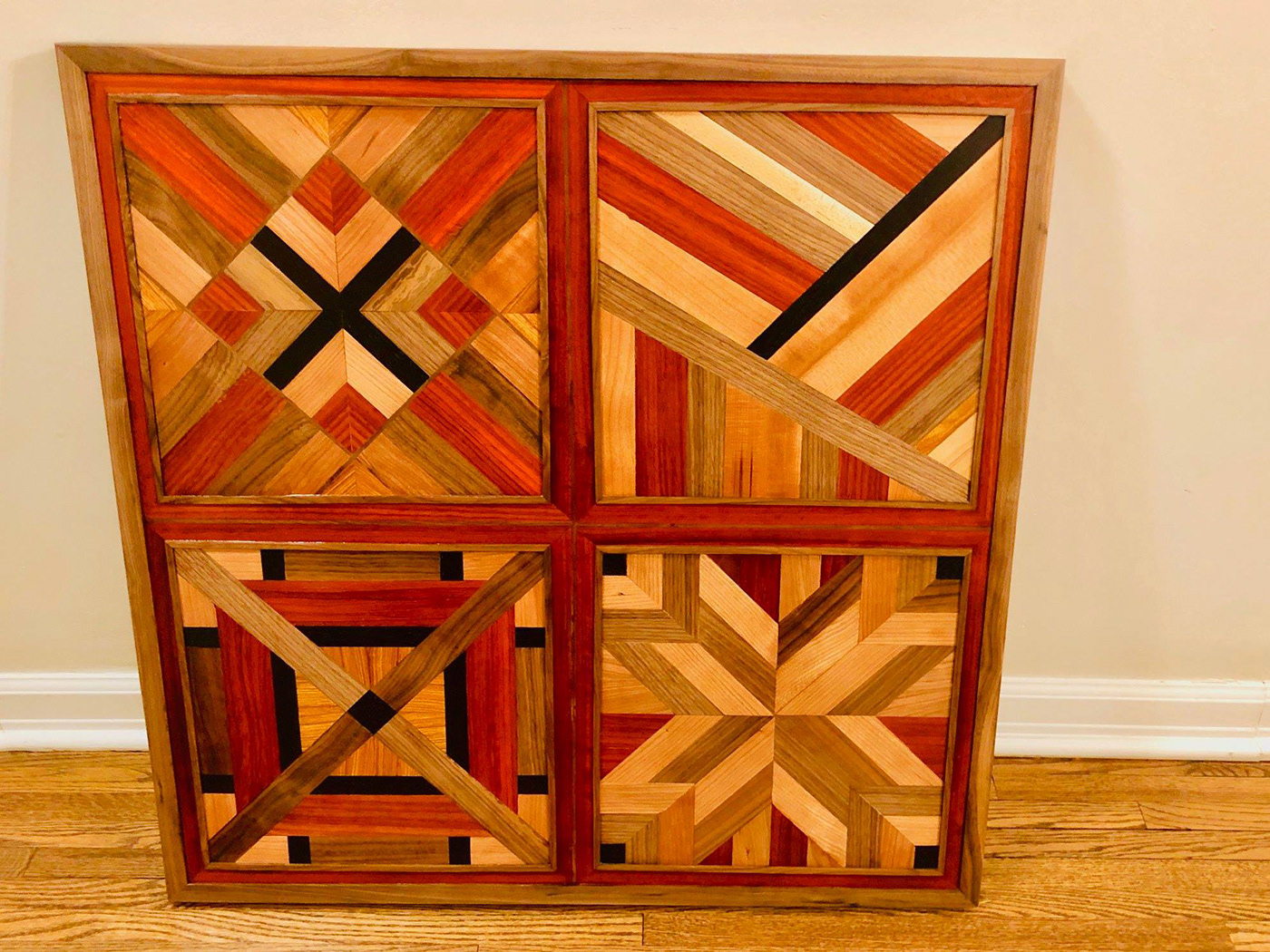 Wall hanging of mixed scrap wood including padauk, walnut, canary wood, cherry, wenge, and alder
