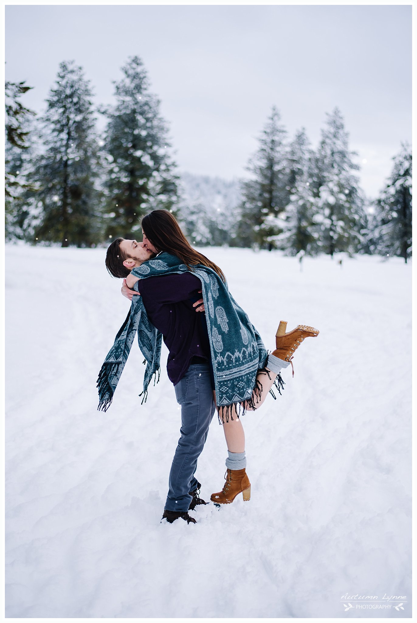 couple-kissing-snowly-engagment-session-ideas-idaho