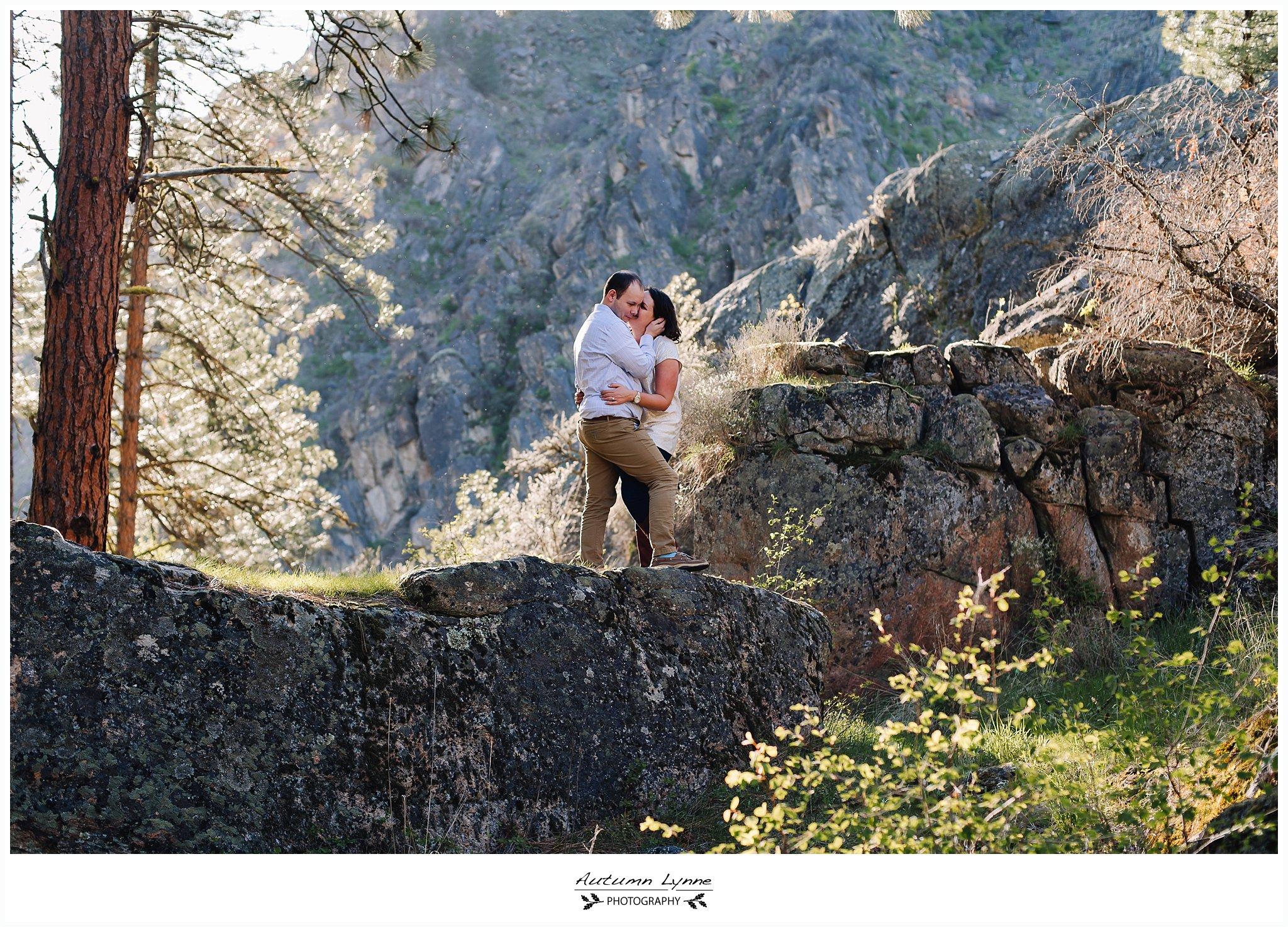 Idaho-adventure-engagement-session-couple-on-rock.jpg