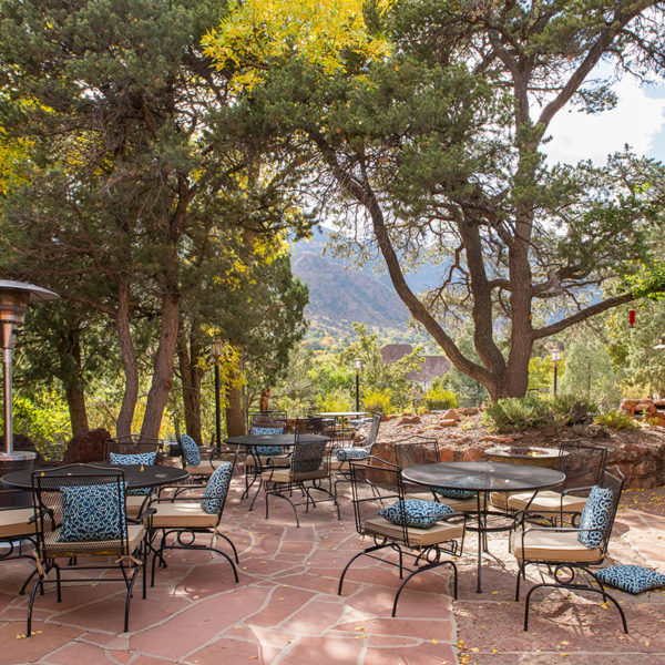 Outdoor eating space with a view of Pikes Peak.
