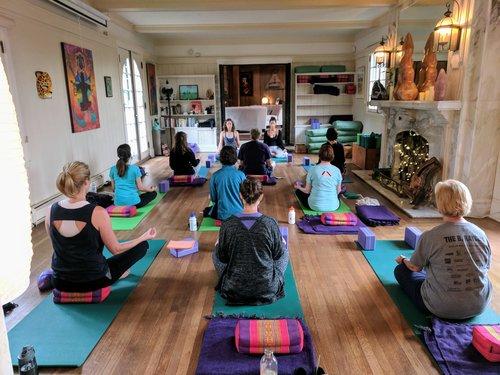 Group yoga lesson at Yoga Retreat in Colorado
