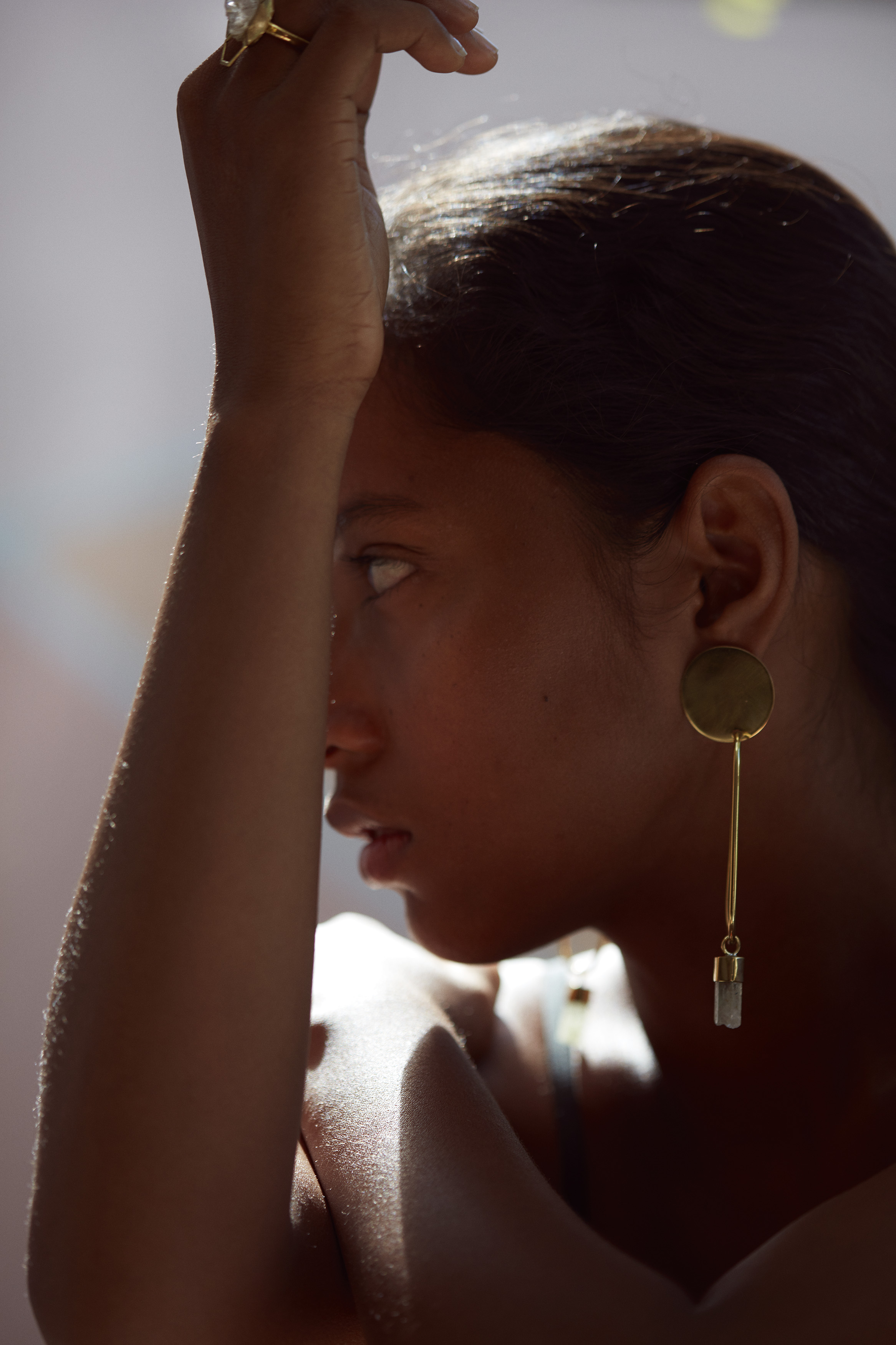 'Grandfather's Clock' Earring. Photographed by Karina Twiss and modeled by Agatha.