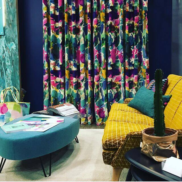 Jenny Bond Interiors, Lisburn Road, Belfast.  Gorgeous bold curtains from Blue Bell Grey matched perfectly with a retro mustard sofa and teal footstool/table.