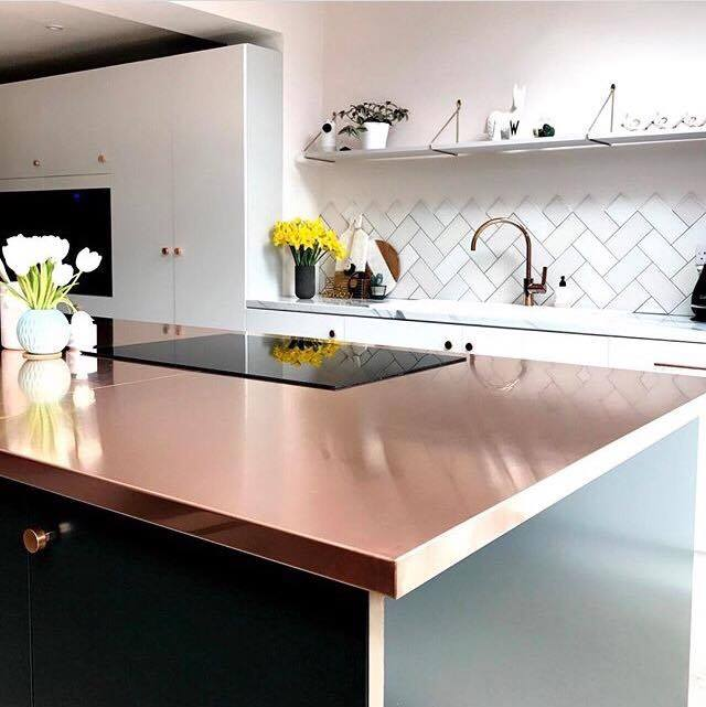 I love this use of copper in Jade's  kitchen. Her work surface is paired beautifully with the green cabinets below to create the  main feature in her kitchen. I love its shiny surface reflecting the rest of the kitchen yet it adds a lovely warmth against the white surroundings.