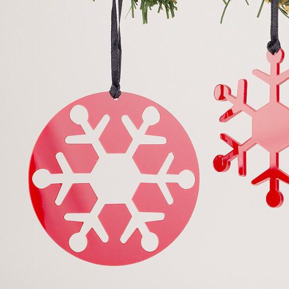 These acrylic snowflake decorations by  Rachel McKnight  inside each other, perfect to hang separately on your tree or why not gift one to someone special and keep the matching one. Available at  Oscar and Joy  in Holywood and in  Space Craft