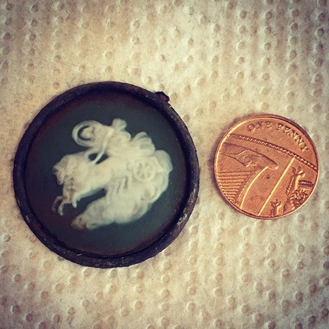 Digging in the garden and found this - any ideas what it is? I've put a filter on to show the relief, penny for scale. Young Master thinks it may be half of a locket. #archaelogy #history #digging