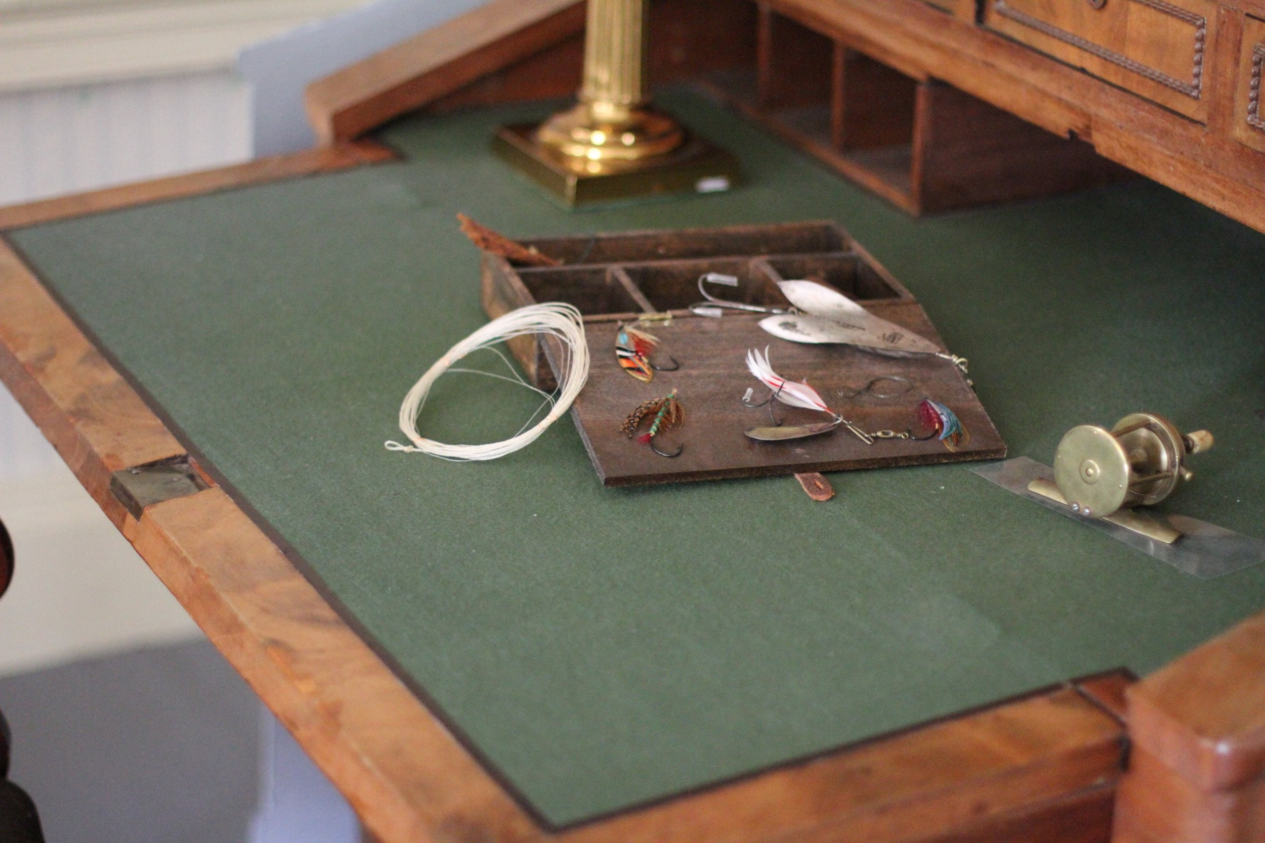 The President's fishing tackle on his writing desk.