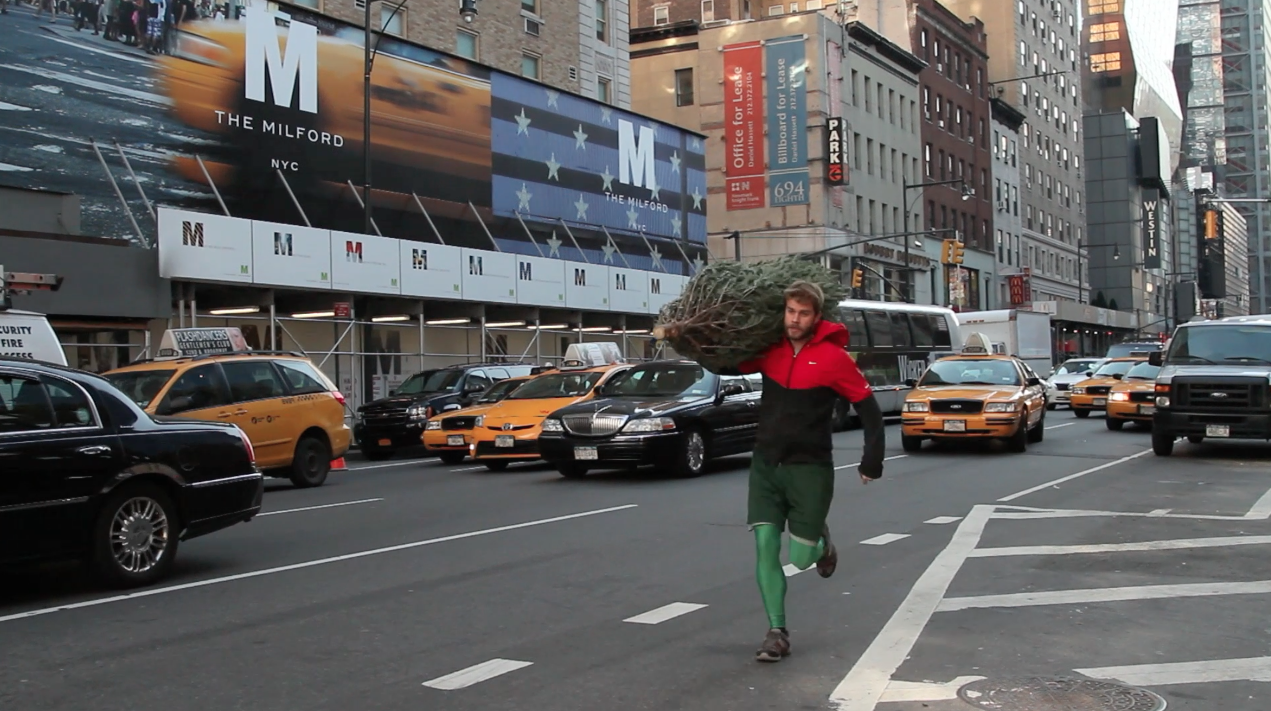 Ultrarunner's NYC Christmas (Short - Comedy)   Who needs delivery? Here's how this New York City ultrarunner gets his Christmas tree home.