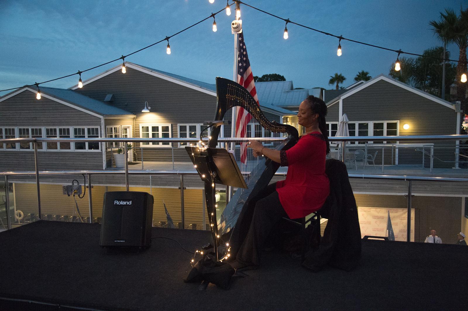 Jennifer Sparks, Harpist and Singer performing on the Sky Deck during cocktail hour.