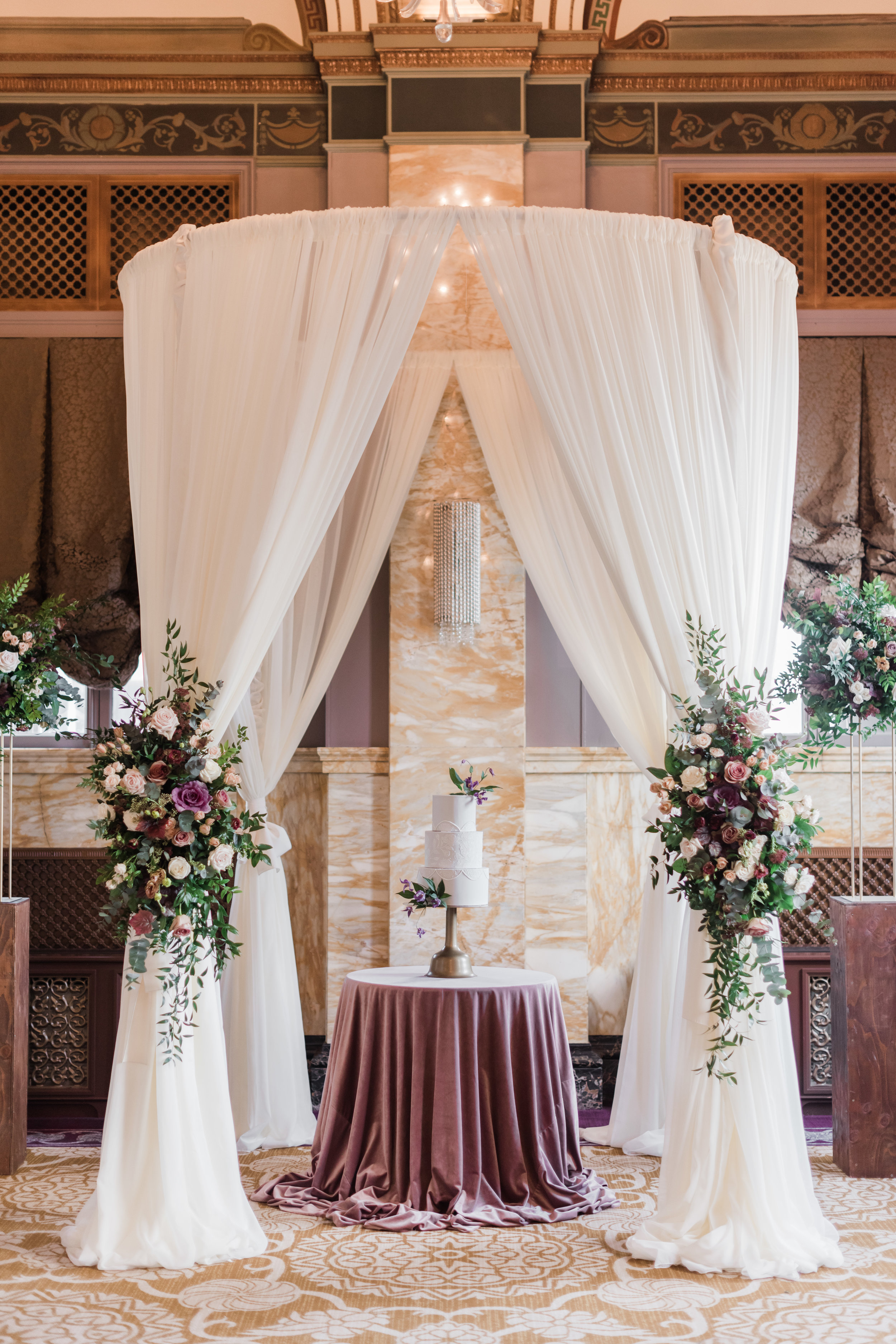Wedding cake backdrop at Sentinel Hotel.