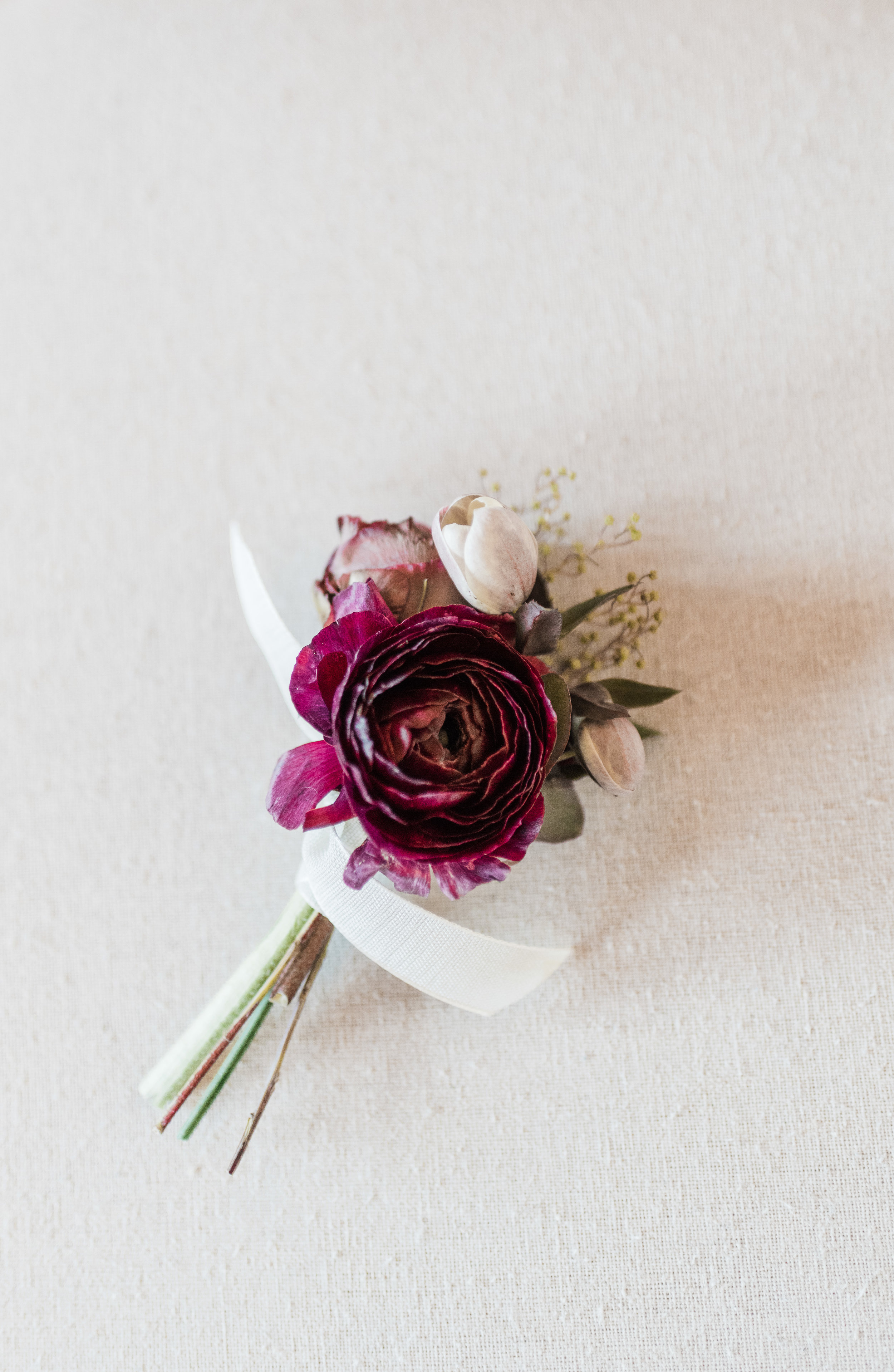 Boutonniere by Bella Bloom Floral           Photo by Deyla Huss Photography