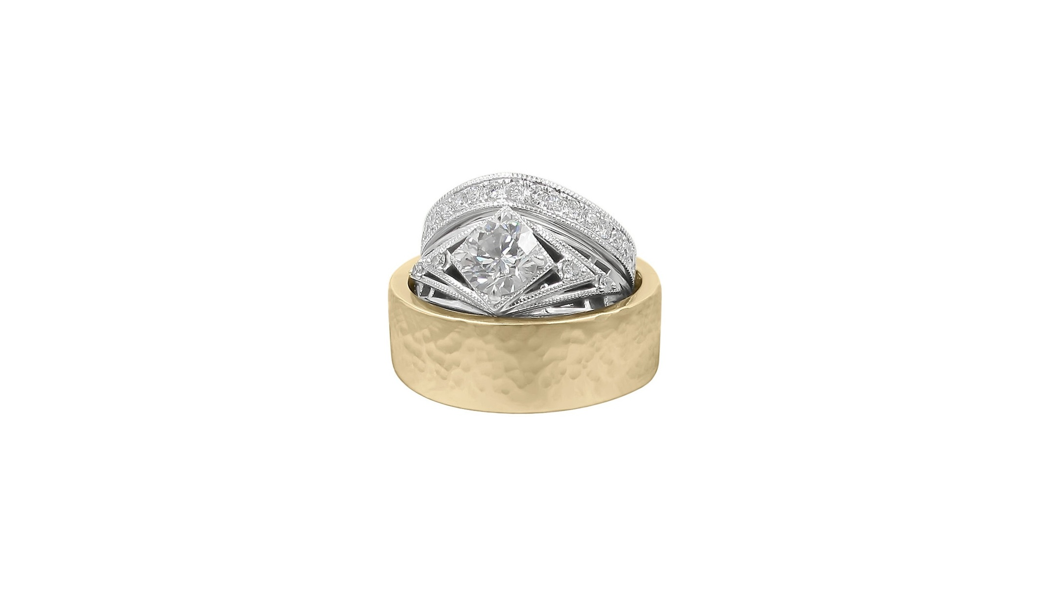 Hers- Art Deco and Comet Inspired 14k White Gold Engagement Ring with Milgrain Edge paired with Custom Fit 14k White Gold Half Eternity Band with Milgrain Edge.    His-Hand Carved 18k Yellow Gold Flat Band with Hammered Satin Finish