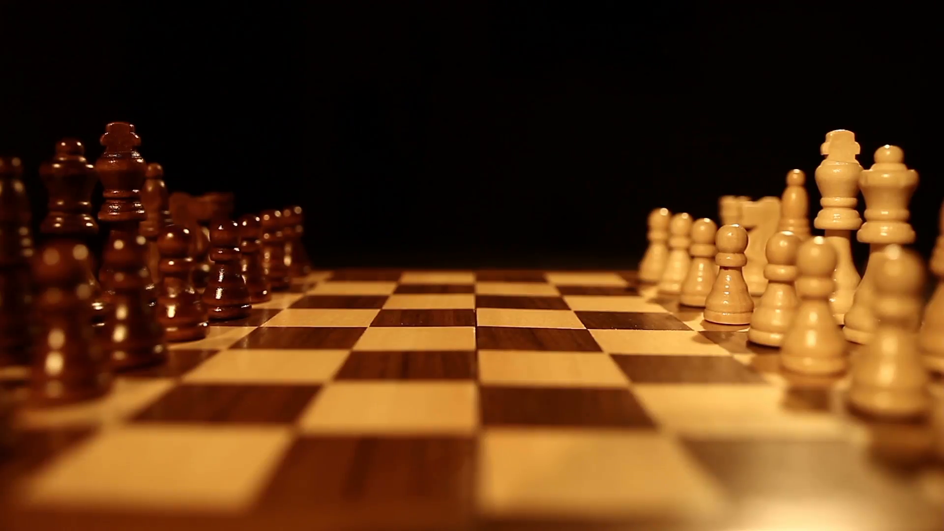 side-shot-of-a-chess-board-over-a-black-background-and-the-chess-pieces-lin_v0iu7ixol__F0000.png