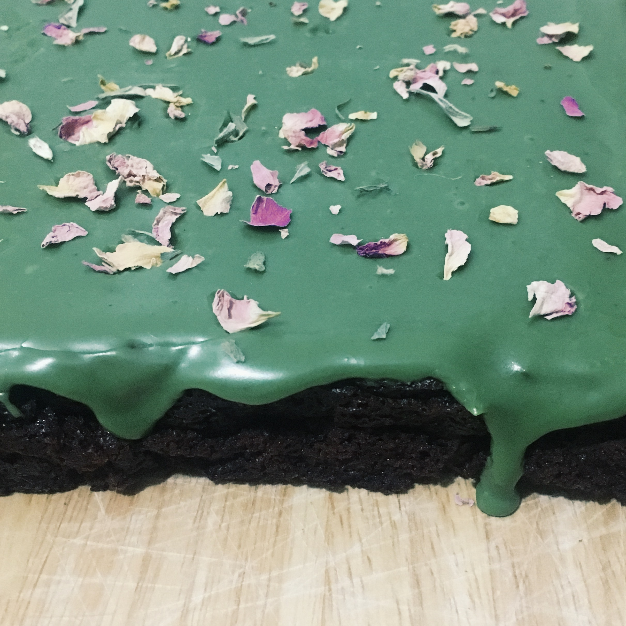 brownies from scratch with matcha icing and rose petals