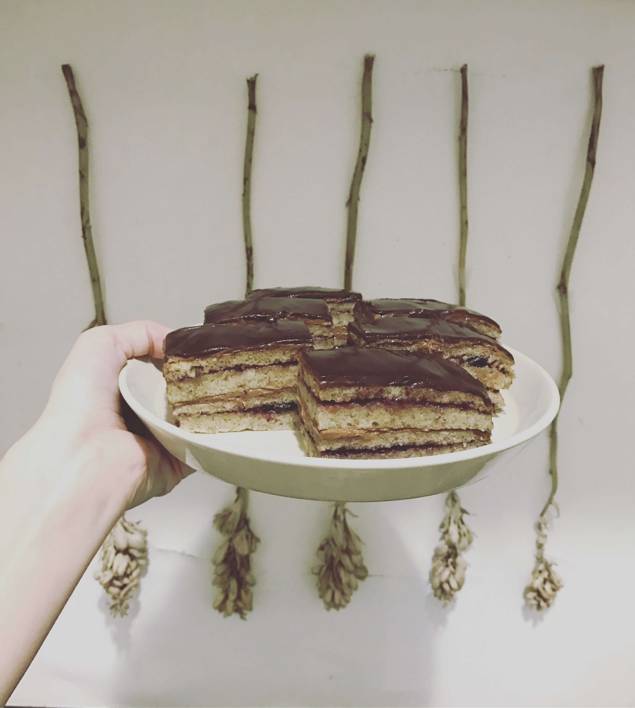 """""""opera cake"""" almond sponge, layered with chocolate buttercream and black currant jam, covered in chocolate ganache. my best yet"""
