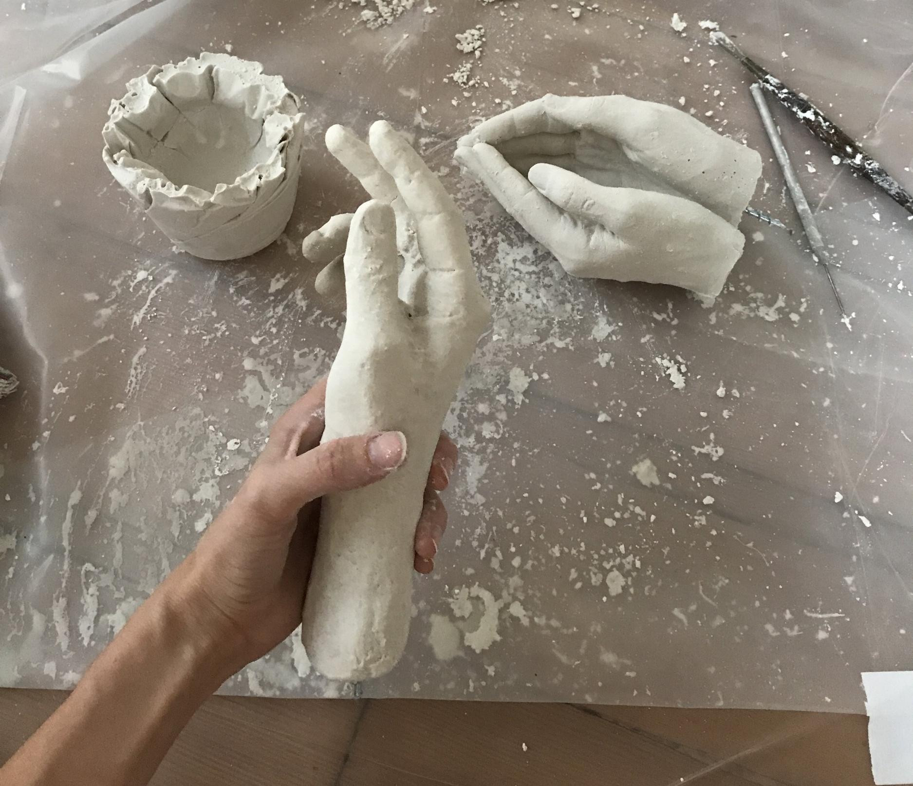 Hand studies in plaster of paris.