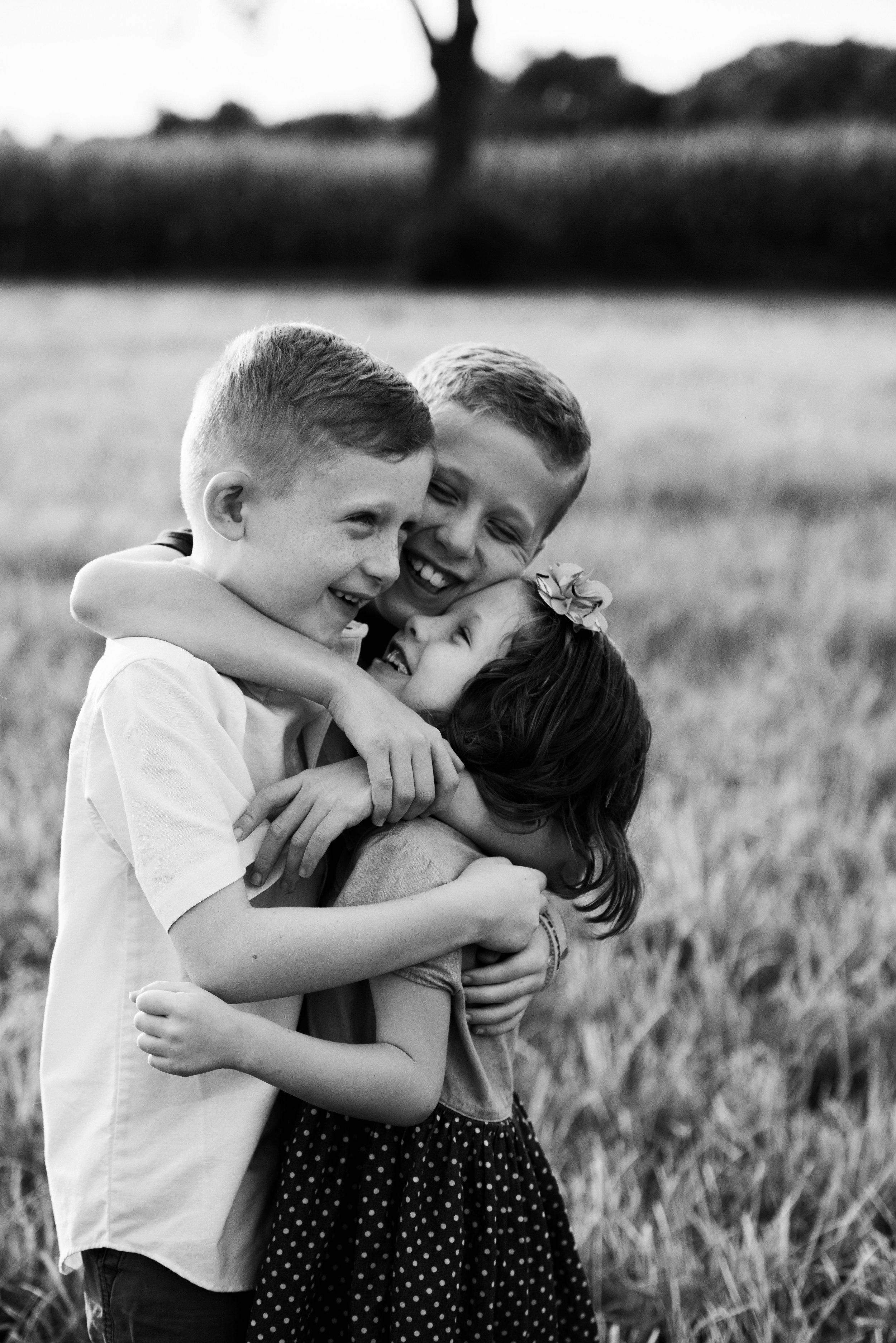 kids hugging each other in bw-4838.jpg