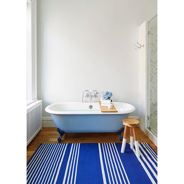 Cool, crisp blues and the simplicity of one, bold color. A bathroom project we worked on with @langarchitecture | @tycole