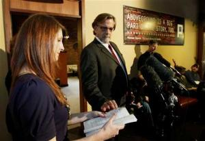 Emily Gause alongside John Henry Brown, on Staff Sgt. Robert Bales proceedings