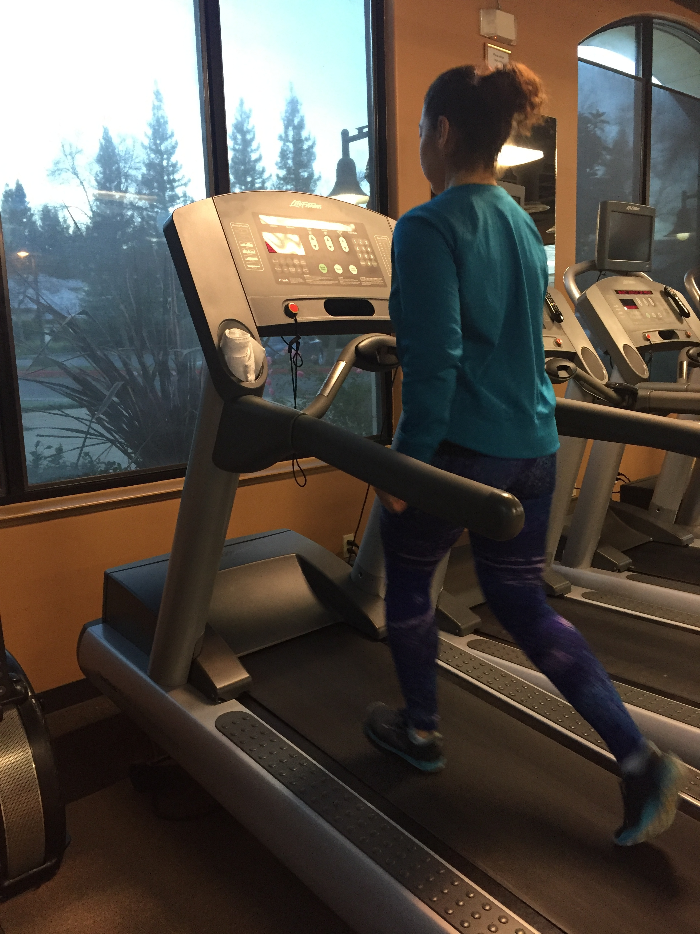 Milly Nuñez, certified personal trainer and nutrition coach, demonstrates proper posture when using the incline mode.