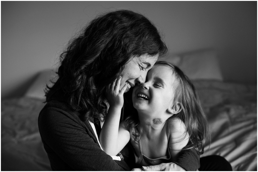 Lifestyle Family Photographer Rochester NY mama and little girl smiling