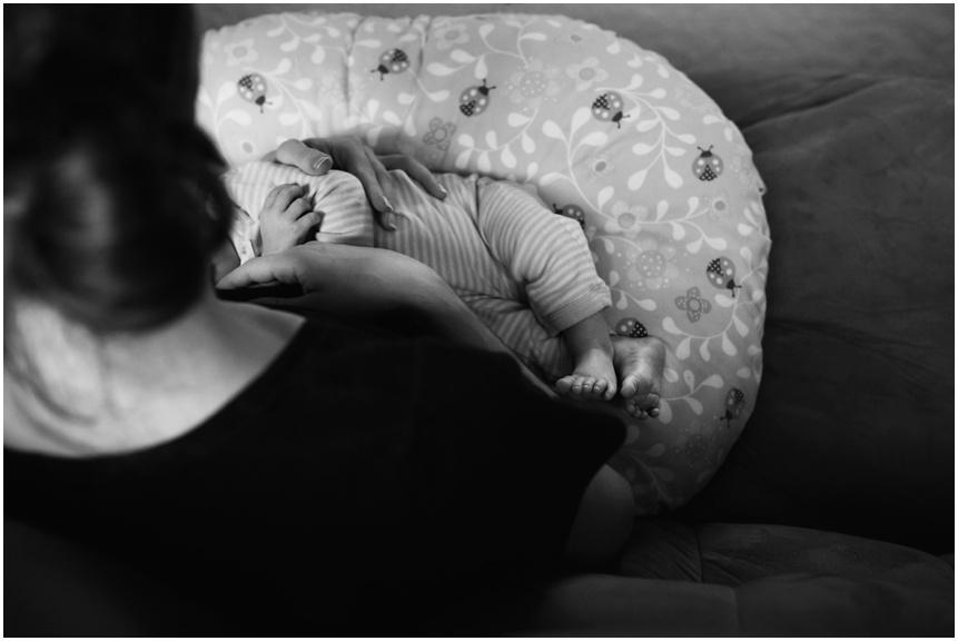 Lifestyle Newborn Photographer rochester NY baby nursing