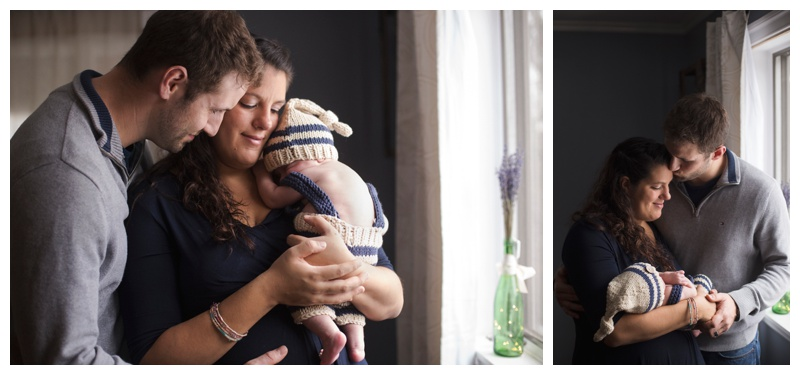 Rochester NY Lifestyle Newborn Photographer Mom and Dad snuggling new baby