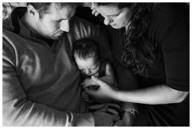 Newborn Photographer Rochester NY Baby cradled in dad's arm