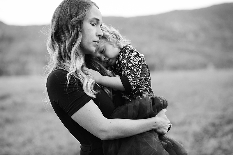 Rochester Family Photographer Mama embracing little girl