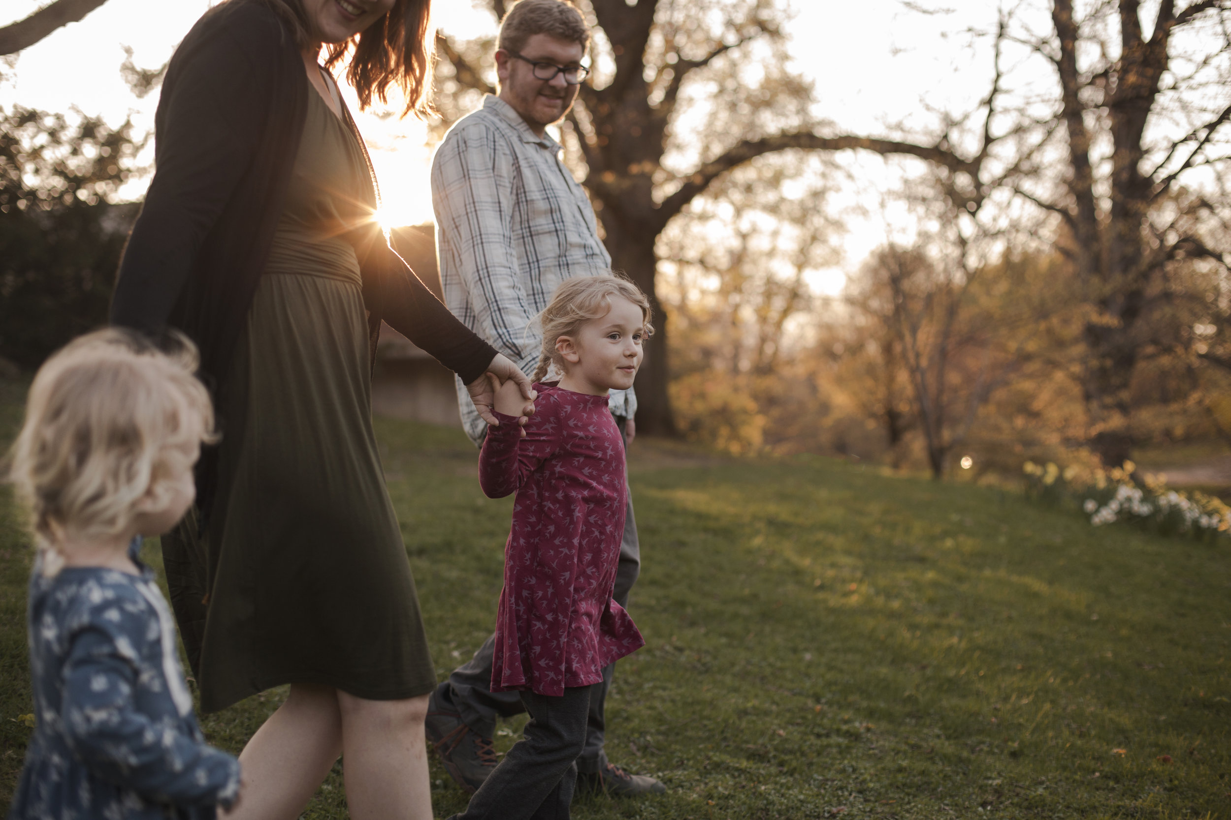 Rochester NY Family Photographer, family walking in setting sun at Highland Park
