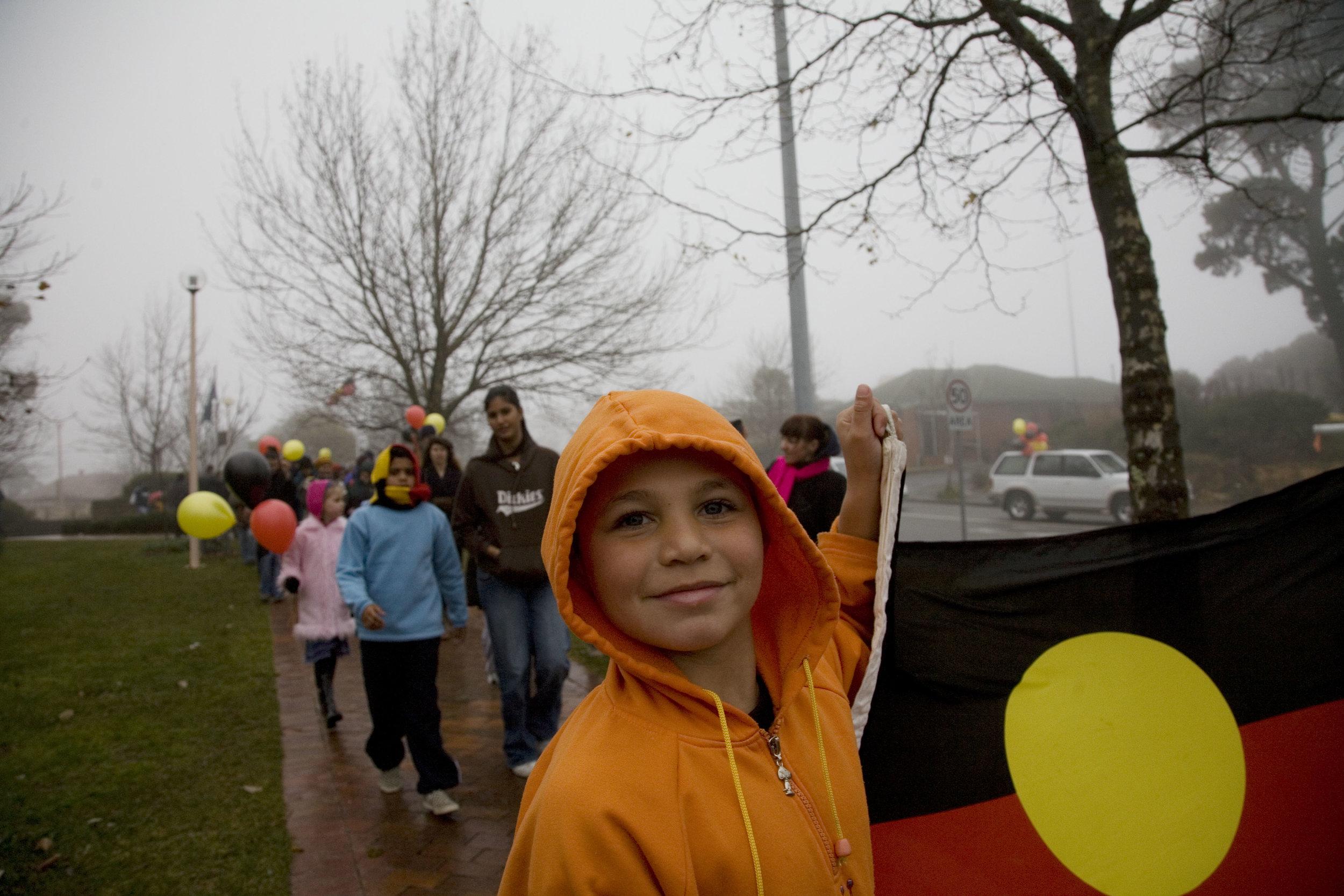 Proud of Aboriginal culture. Boy with Aboriginal flag