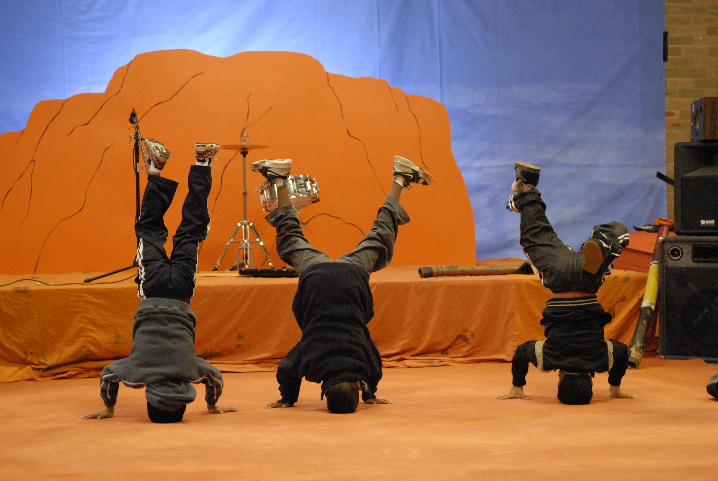 Aboriginal boys and fun in front of Uluru prop for the Kangaroo Rock clip