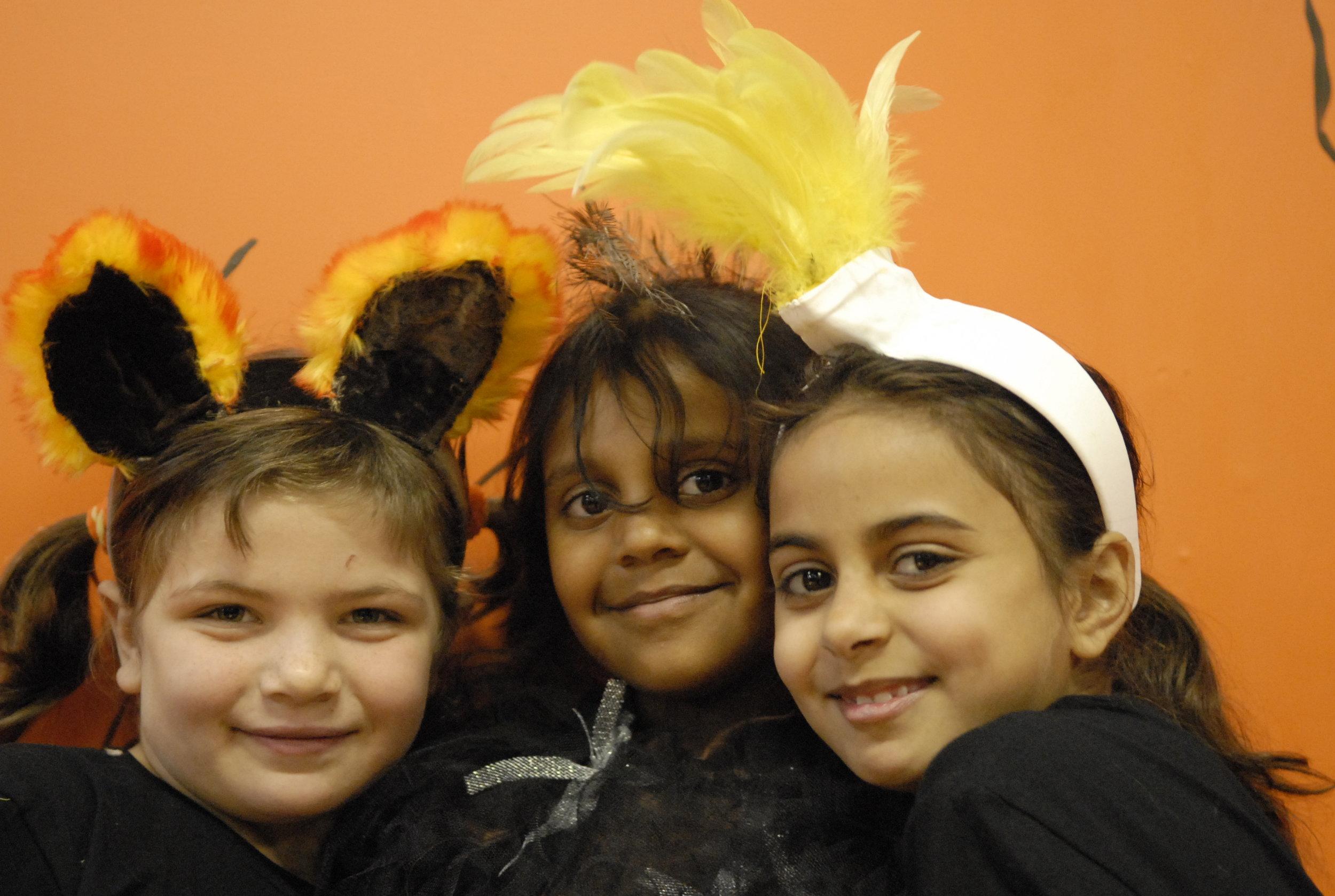 Aboriginal girls happy in costume as native Australain animals dingo, emu and cockatoo for the Kangaroo Rock video clip