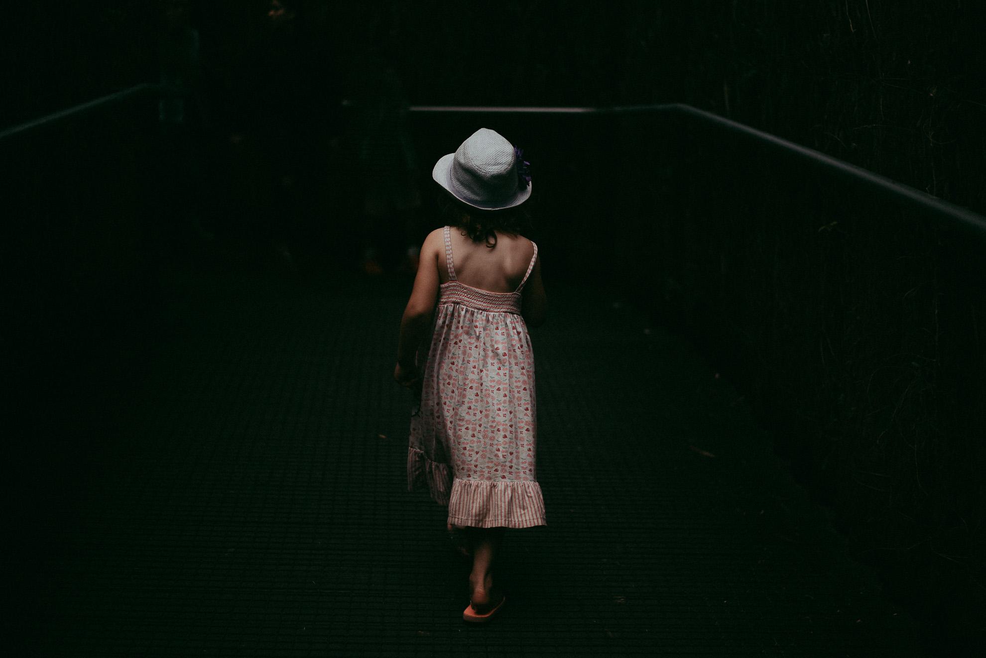 girl walking in the harsh direct light