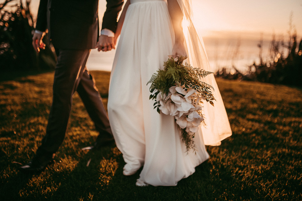 couple walking in the beautiful sunset light