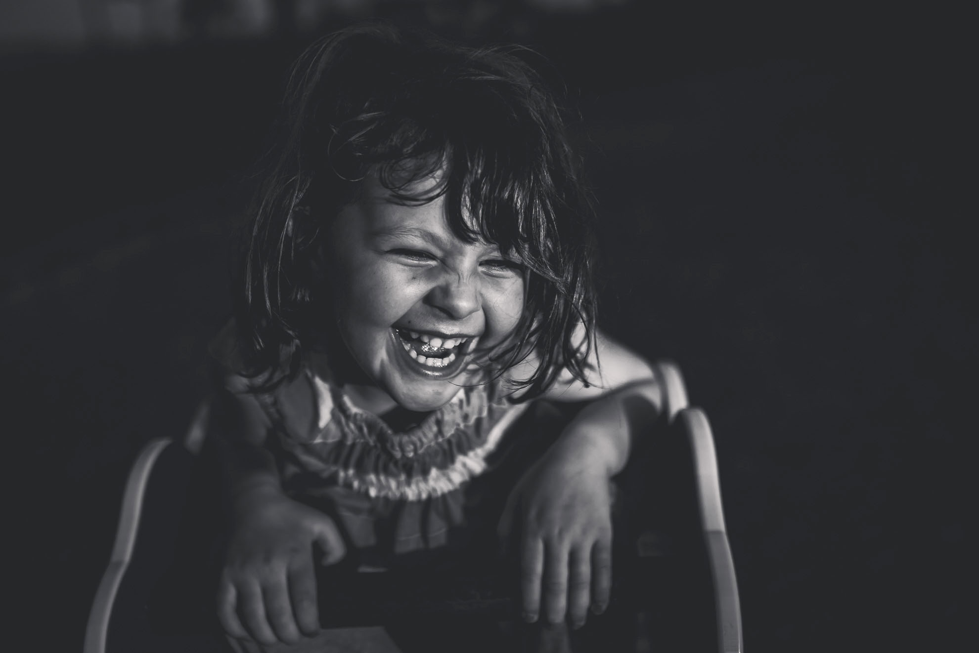 girl laughing in the playground -