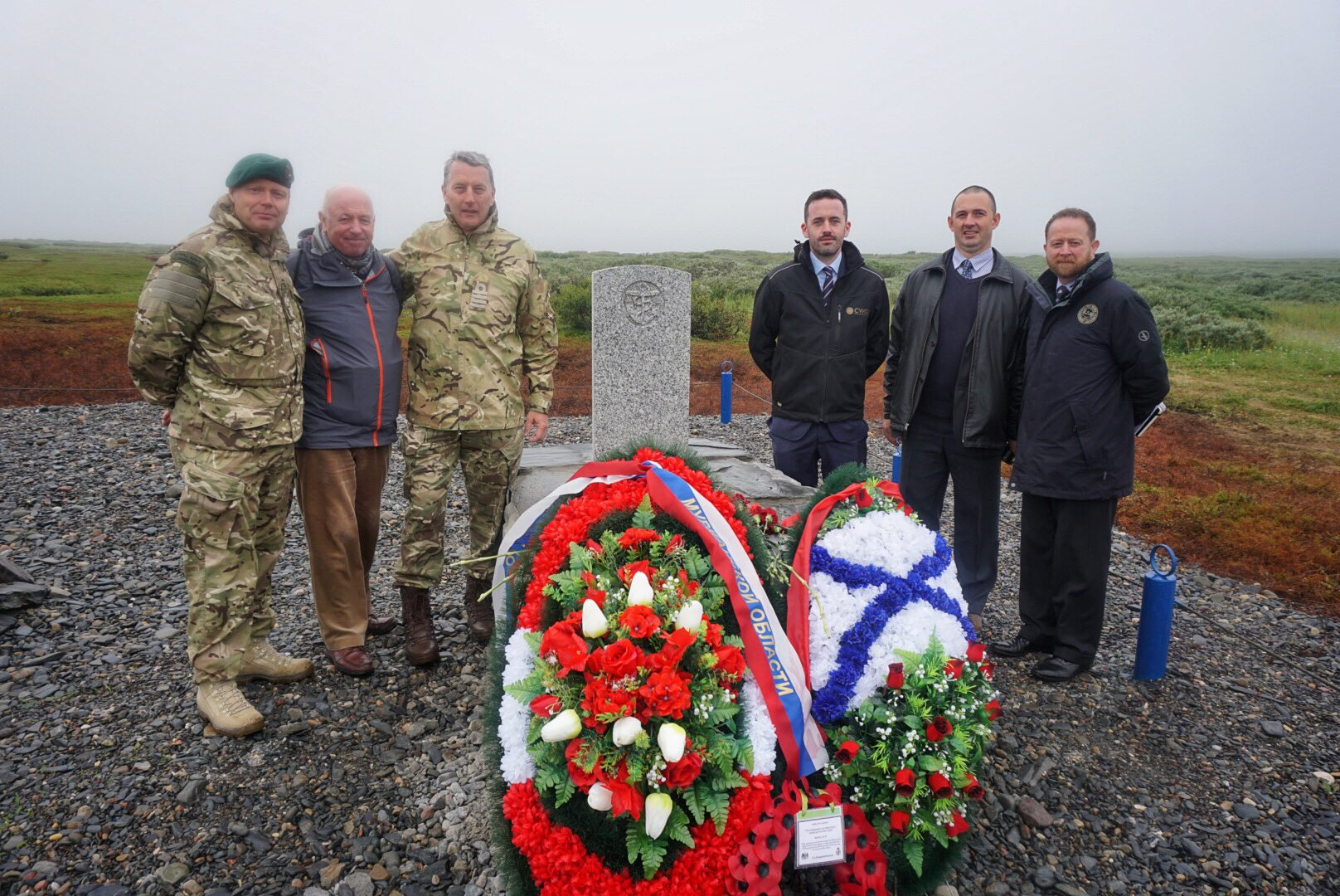 The British Delegation at the grave: left to right - Reverend Ian Wheatley (Chaplain of the Fleet), Andrew Furlong (relative of Seymour Burke), Capt. Christopher Connolly, Misha Titov (Translator – Defence Section)