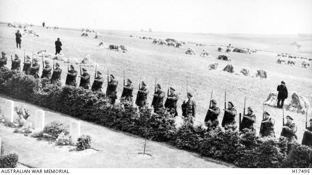 French soldiers salute the Memorial, surrounded by gardens and hay fields (AWM H17495)