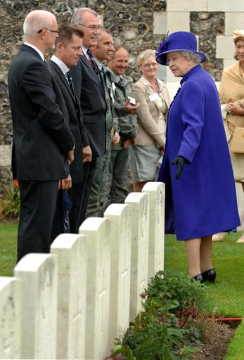 Britain's Queen Elizabeth II meets members of the Commonwealth War Graves Commission during a visi to the Tyne Cot War Cemetery, Passchendaele, for WWI Commonwealth soldiers.